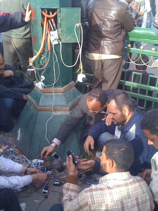 Recharging cellphones in Tahrir Square